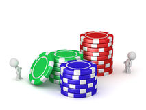 Small 3D Characters and Stacks of Poker Chips Stock Images