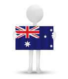 Small 3d man holding a flag of Ashmore and Cartier Islands Royalty Free Stock Images