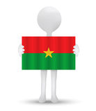 Small 3d man holding a flag of Burkina Faso Royalty Free Stock Image
