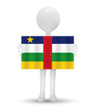 Small 3d man holding a flag of Central African Republic Royalty Free Stock Photos