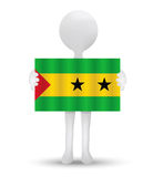 Small 3d man holding a flag of Democratic Republic of Sao Tome and Principe Royalty Free Stock Photo