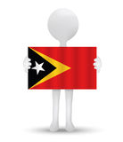 Small 3d man holding a flag of Democratic Republic of Timor-Leste Royalty Free Stock Images