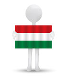 Small 3d man holding a flag of Hungary Royalty Free Stock Photography