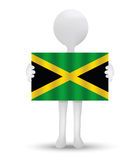 Small 3d man holding a flag of Jamaica Royalty Free Stock Images