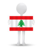 Small 3d man holding a flag of Lebanese Republic Royalty Free Stock Images