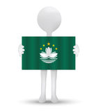 Small 3d man holding a flag of Macau SAR China Royalty Free Stock Photography