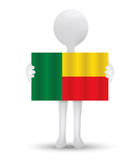 Small 3d man holding a flag of Republic of Benin Royalty Free Stock Photography