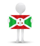Small 3d man holding a flag of Republic of Burundi Royalty Free Stock Photo