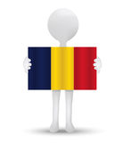 Small 3d man holding a flag of Republic of Chad Royalty Free Stock Photo