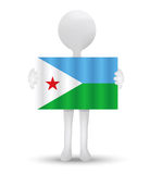 Small 3d man holding a flag of Republic of Djibouti Royalty Free Stock Photos