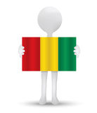 Small 3d man holding a flag of Republic of Guinea Royalty Free Stock Image