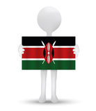 Small 3d man holding a flag of Republic of Kenya Royalty Free Stock Photo