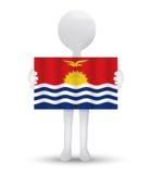 small 3d man holding a flag of Republic of Kiribati Royalty Free Stock Photo