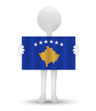 Small 3d man holding a flag of Republic of Kosovo Royalty Free Stock Photo