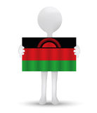 Small 3d man holding a flag of Republic of Malawi Royalty Free Stock Photography