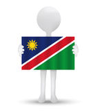 small 3d man holding a flag of Republic of Namibia Royalty Free Stock Photo
