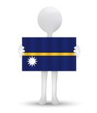 small 3d man holding a flag of Republic of Nauru Royalty Free Stock Images
