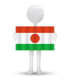 Small 3d man holding a flag of Republic of Niger Royalty Free Stock Photo