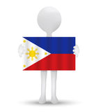 Small 3d man holding a flag of Republic of the Philippines Royalty Free Stock Image