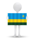 small 3d man holding a flag of Republic of Rwanda Royalty Free Stock Images