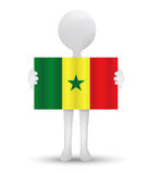 Small 3d man holding a flag of Republic of Senegal Royalty Free Stock Images