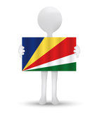 Small 3d man holding a flag of Republic of Seychelles Royalty Free Stock Images