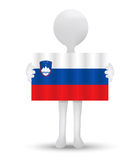 small 3d man holding a flag of Republic of Slovenia Royalty Free Stock Photography