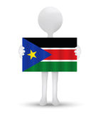 Small 3d man holding a flag of Republic of South Sudan Royalty Free Stock Photography