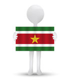 Small 3d man holding a flag of Republic of Suriname Royalty Free Stock Photography