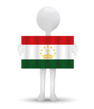 Small 3d man holding a flag of Republic of Tajikistan Royalty Free Stock Images