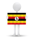 small 3d man holding a flag of Republic of Uganda Royalty Free Stock Images