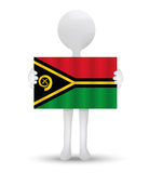Small 3d man holding a flag of Republic of Vanuatu Royalty Free Stock Photos