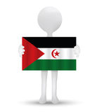 Small 3d man holding a flag of Western Sahara Royalty Free Stock Photography