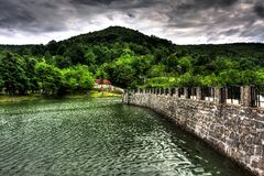 Lake Dam. Small dam in the mountains Stock Photo