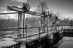 Small dam on Oredezh River, monochrome Stock Photos