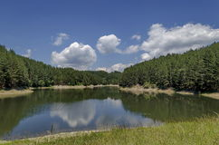 Small dam or reservoir in beautiful mountain Plana. Alino, Bulgaria Royalty Free Stock Photography