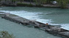 A small dam on the river.  stock footage