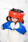 Small dark-haired girl in a protective helmet an Stock Photo