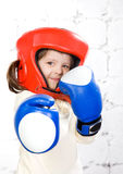 Small dark-haired girl in a protective helmet an Stock Image