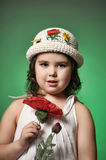 Small dark-haired girl with red poppy Royalty Free Stock Photo