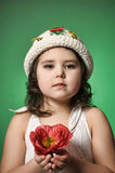 Small dark-haired girl with red poppy Royalty Free Stock Image