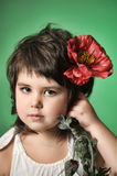 Small dark-haired girl with red poppy Stock Photography