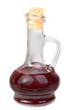 Small decanter with red wine vinegar isolated on w Royalty Free Stock Images