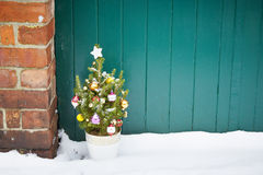 Small decorated christmas tree abandoned Royalty Free Stock Image