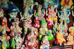 Small decorated god statue for sale. In the sea beach stock photography