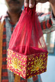 Small decorated red and yellow box in India Royalty Free Stock Images