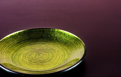 Small decoration plate. Small green decoration plate with clear background Stock Photography
