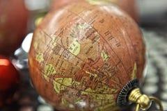 Small decorative antique globe stands . Stock Photo