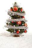 Small decorative christmas tree in artificial snow Stock Photos