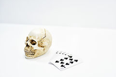 Small decorative human skull with playing cards. Royalty Free Stock Photos